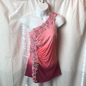 One shoulder embellished top.
